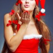 Kissing santa helper girl — Stock Photo #2756733