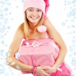 Stock Photo: Miss Santa with gift