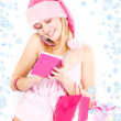 Miss Santa with gift — Stock Photo
