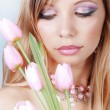 Beautiful woman with tulips — Stock Photo