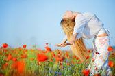 Girl in flower field — Stock Photo