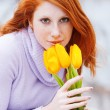 Woman smelling flowers — Stock Photo #2761325
