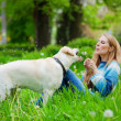 Stock Photo: Woman with labrador