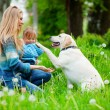 Woman with girl and dog — Stock Photo #2768288