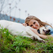 Girl with her dog — Stock Photo #2768432