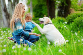 Woman with girl and dog — Stock Photo