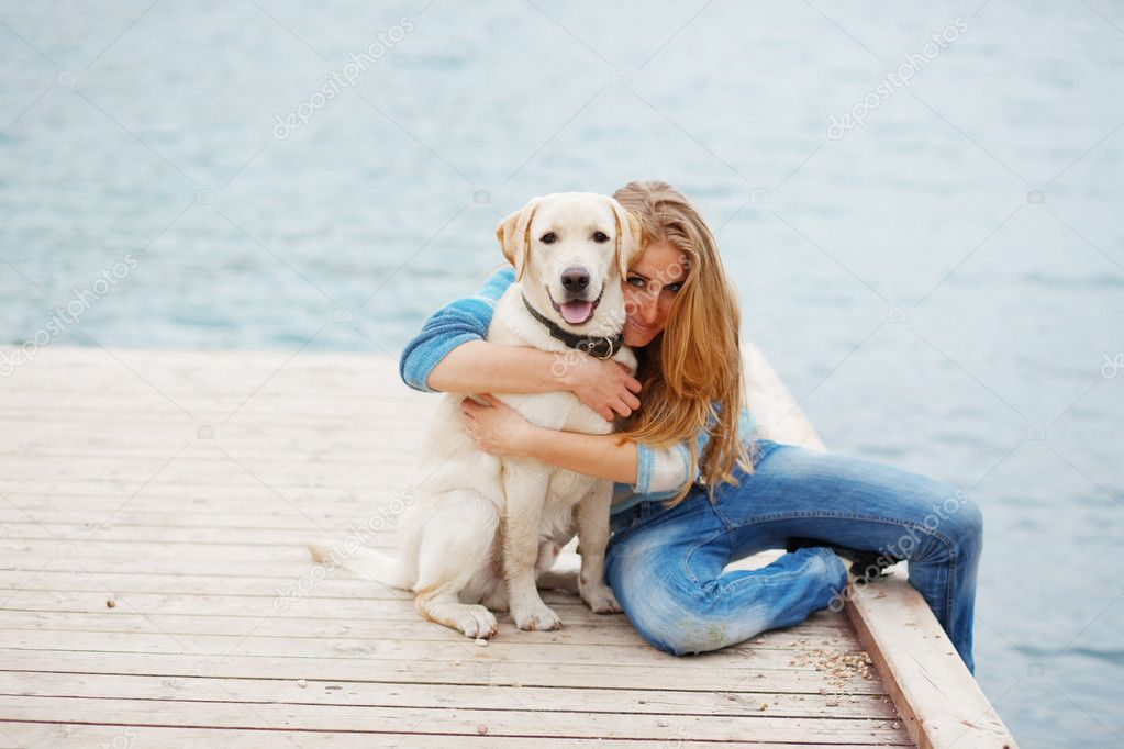 Beautiful girl with her dog on berth near sea  Stock Photo #2768529