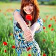 Smiling girl giving flower — Stock Photo