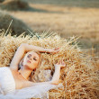 Bride resting in hay stack — Stock Photo #2772175
