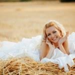 Bride in hay stack — Stock Photo