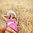Pin-up girl resting in haystack — Stock Photo