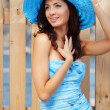 Beautiful female in blue lady's hat — Stock Photo