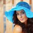 Stock Photo: Beautiful female in blue lady's hat