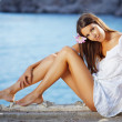 Beautiful female with slim legs - Stock Photo