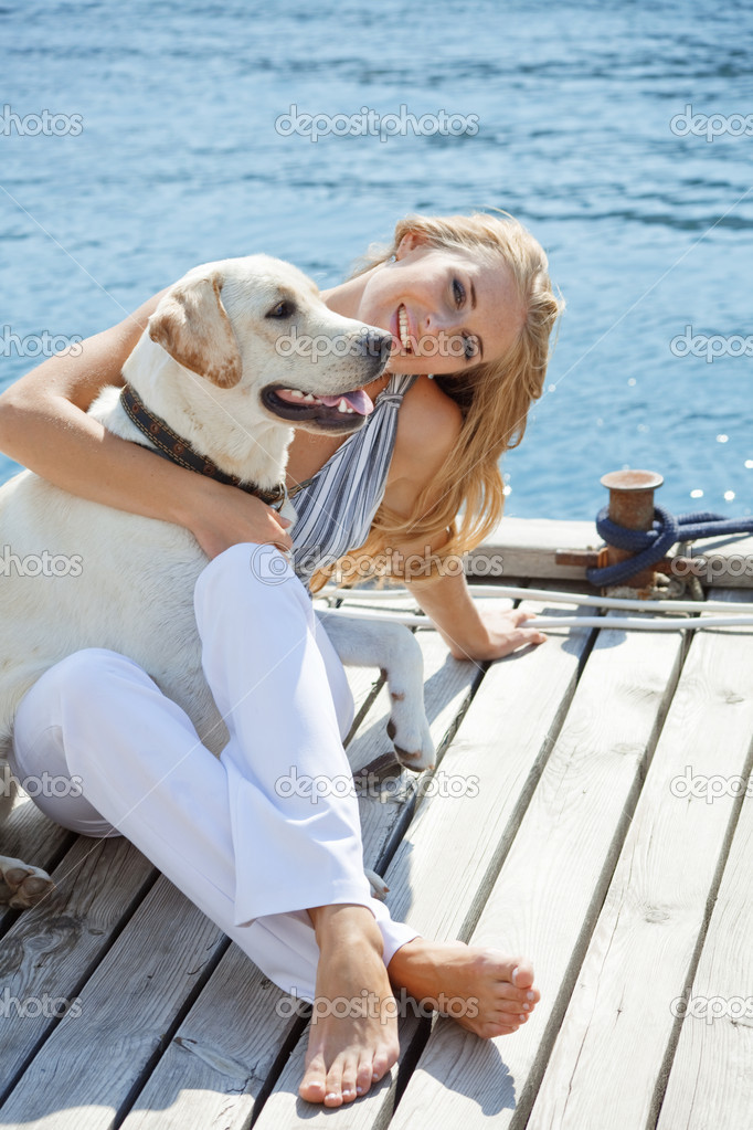 Portrait of young girl with her dog  Stock Photo #2773245