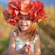 Child in autumn — Stok fotoğraf