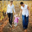 Parents with baby in autumn — Stock Photo #2780372