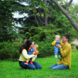 Foto Stock: Happy parents with twins