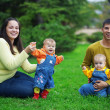 Happy parents with twins - Stockfoto