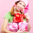 Cheerful girl with gift — Stock Photo