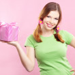 Cheerful girl with gift — Stock Photo #2783307