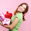 Cheerful girl with presents — Stock Photo