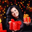 Cute woman with presents at night — Stock Photo #2783769