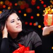 Cute woman with presents at night — Stock Photo