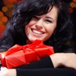 Cute woman with presents at night — Stock Photo #2783828