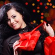 Cute woman with presents at night — Stock Photo #2783836