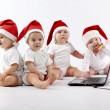 Christmas babies with laptop — ストック写真