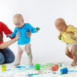 Babies painting with parents — Stock Photo