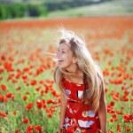 Girl in poppy field — Stock Photo
