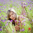 Girl in floral field — Stock fotografie