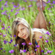 Girl in floral field — Stock Photo #2786708