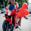 Stock Photo: Fashion model on motorcycle