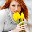 Stock Photo: Woman smelling flowers