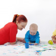 Royalty-Free Stock Photo: Babies painting with parents