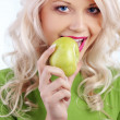 Woman holding green apple — Foto de Stock