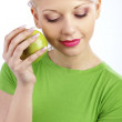 Woman holding green apple — Stock Photo