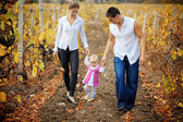 Parents with baby in autumn — Stock Photo