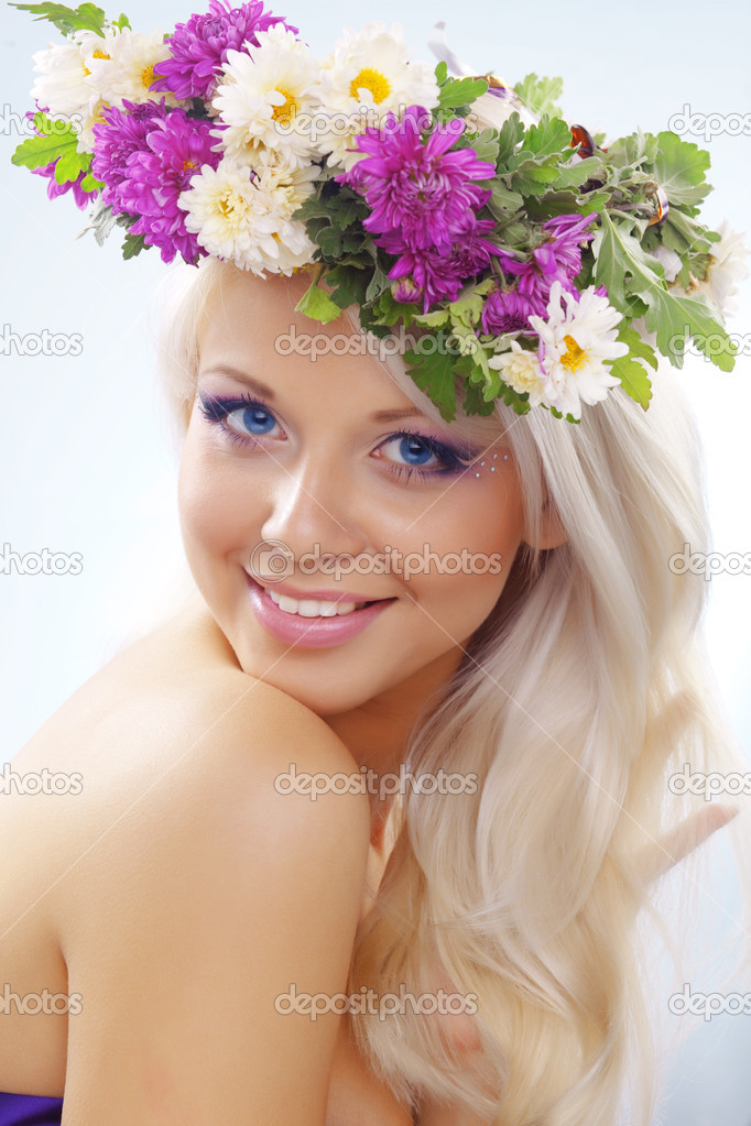Beautiful youg girl wearing floral wreath closeup  Stock Photo #2781941