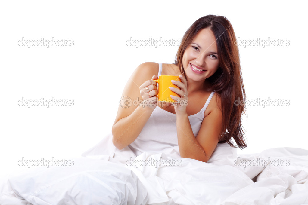 Studio portrait of young beautiful woman on bed — Stock Photo #2783334