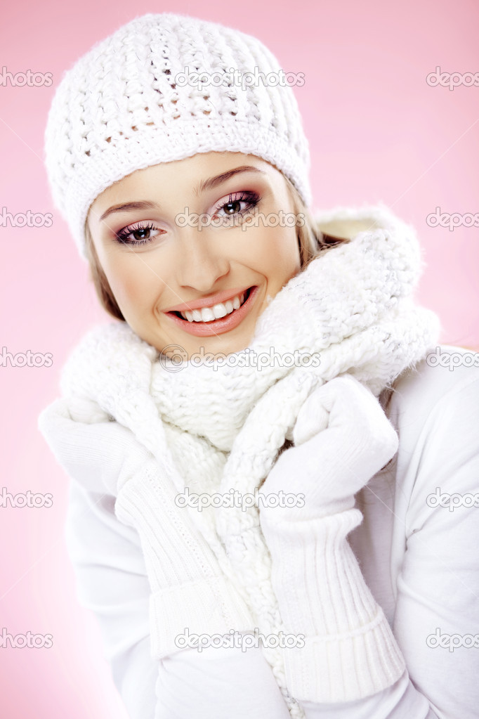 Close-up portrait of beautiful pure young woman wearing white winter clothing — Stock Photo #2783620