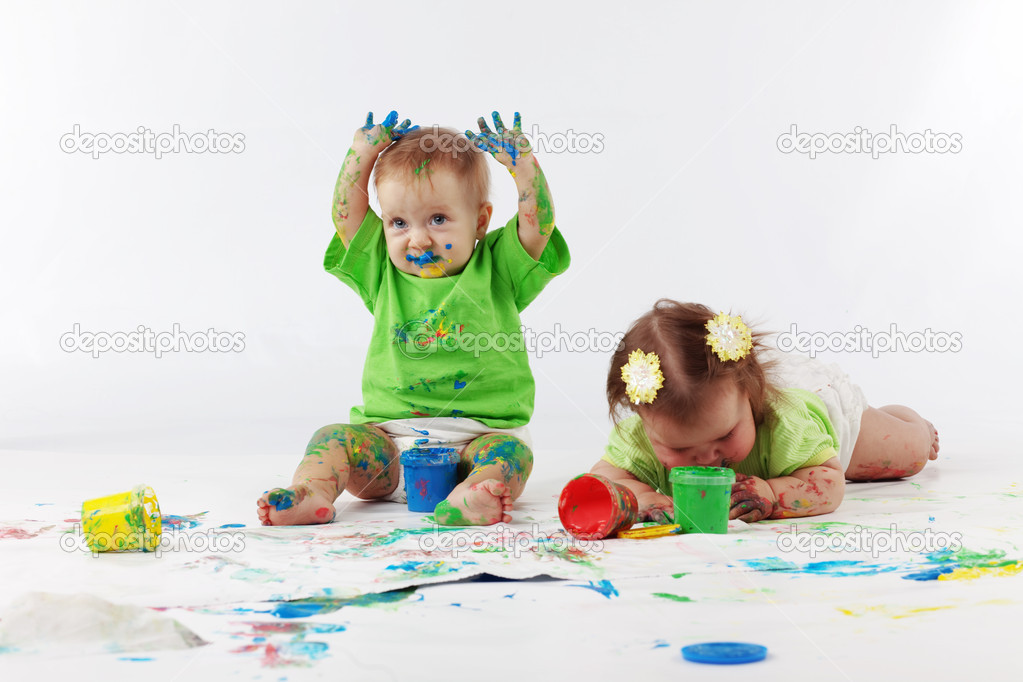 Two babies painting on white background — Stock Photo #2784325
