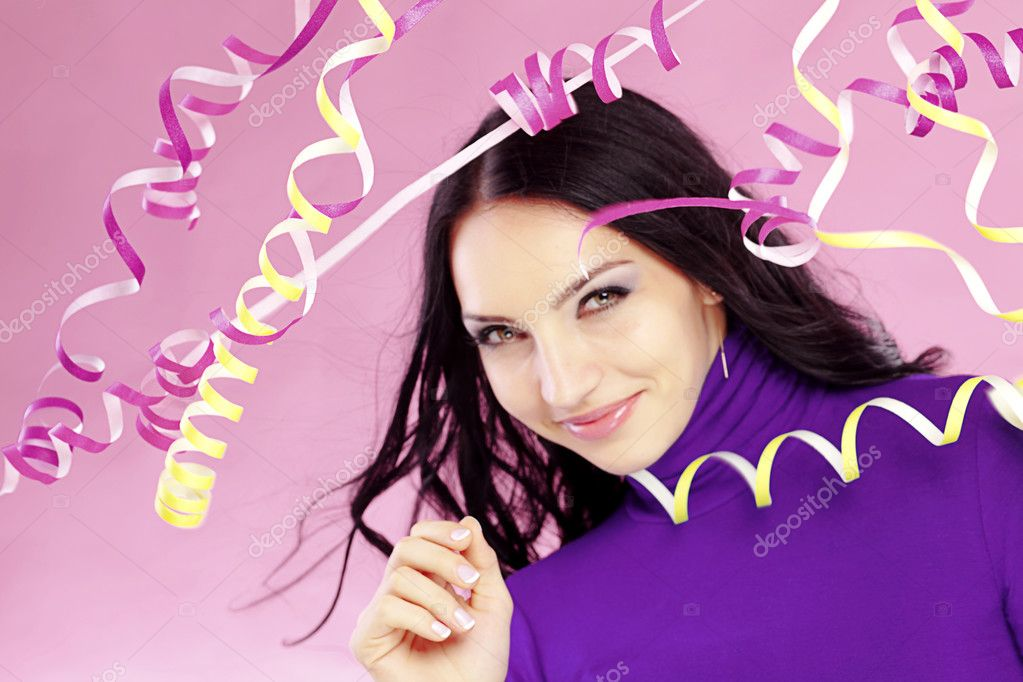 Portrait of beautiful woman with holiday paper streamer  Stock Photo #2788204