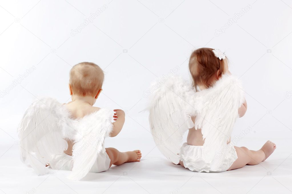 Two cute valentine angel babies sitting back on light studio background  Stock Photo #2788285