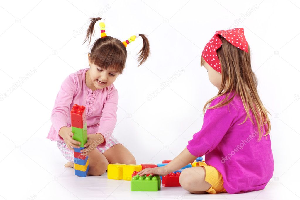 Portrait of two kids playing with constructor over white  Stock Photo #2788407