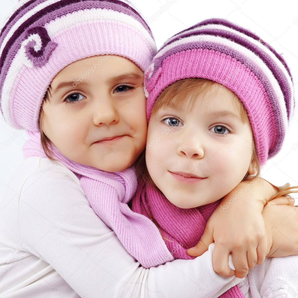 Portrait of lovely embracing kid girls wearing winter clothing  Stock Photo #2788544