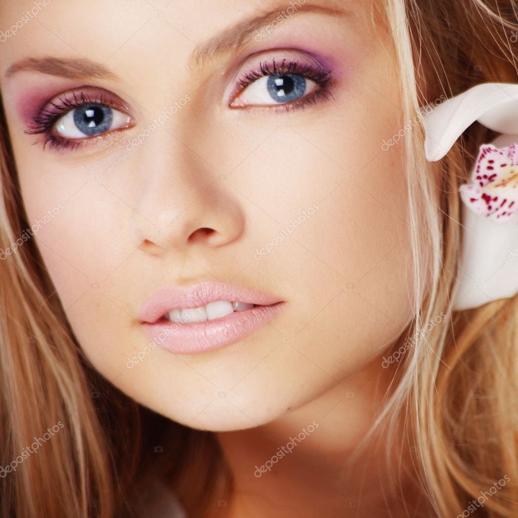 Portrait of very beautiful woman with orchid in her hair  Stock Photo #2788991